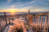 Sunrise as seen from the sand dunes at the Outer Banks, NC around Corolla Beach in September, 2014.