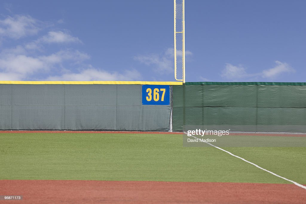 Outfield fence on baseball field. : Stock Photo