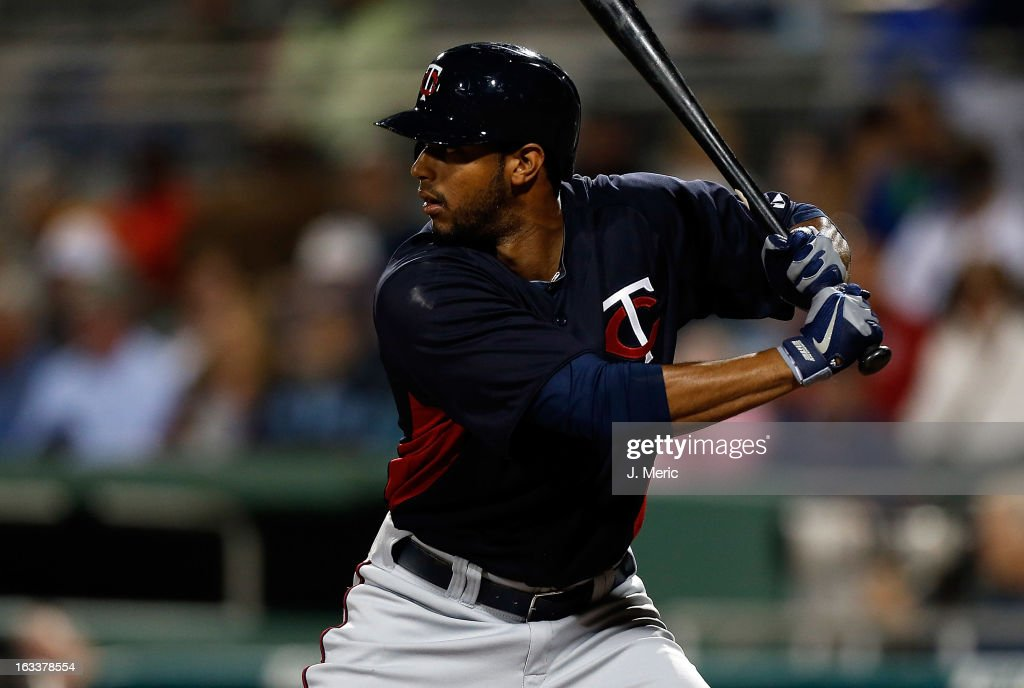Outfielder Aaron Hicks #63 of the Minnesota Twins bats against the Boston Red Sox during a Grapefruit League Spring Training Game at JetBlue Park on March 8, 2013 in Fort Myers, Florida.