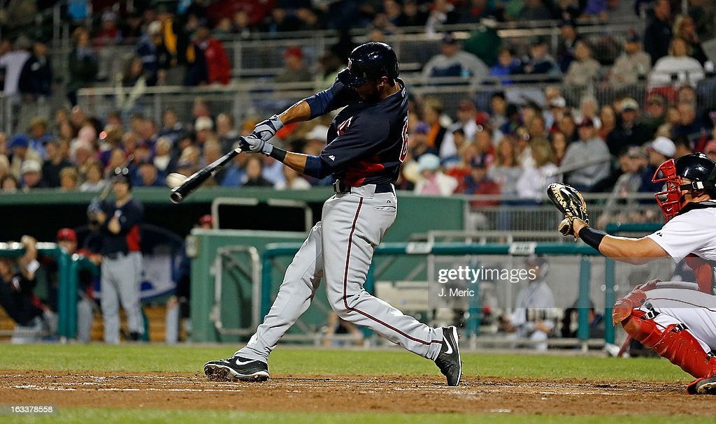 Outfielder Aaron Hicks #63 of the Minnesota Twins double against the Boston Red Sox during a Grapefruit League Spring Training Game at JetBlue Park on March 8, 2013 in Fort Myers, Florida.