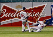 Outfielder Aaron Hicks of the Minnesota Twins makes a sliding catch against the Tampa Bay Rays during the game at Tropicana Field on July 10 2013 in...