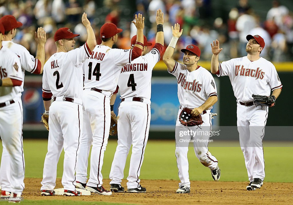 Outfielder <a gi-track='captionPersonalityLinkClicked' href=/galleries/search?phrase=Adam+Eaton&family=editorial&specificpeople=210898 ng-click='$event.stopPropagation()'>Adam Eaton</a> (second from right) #6 of the Arizona Diamondbacks high fives teammates after defeating the Chicago Cubs in the MLB game at Chase Field on July 25, 2013 in Phoenix, Arizona. The Diamondbacks defeated the Cubs 3-1.