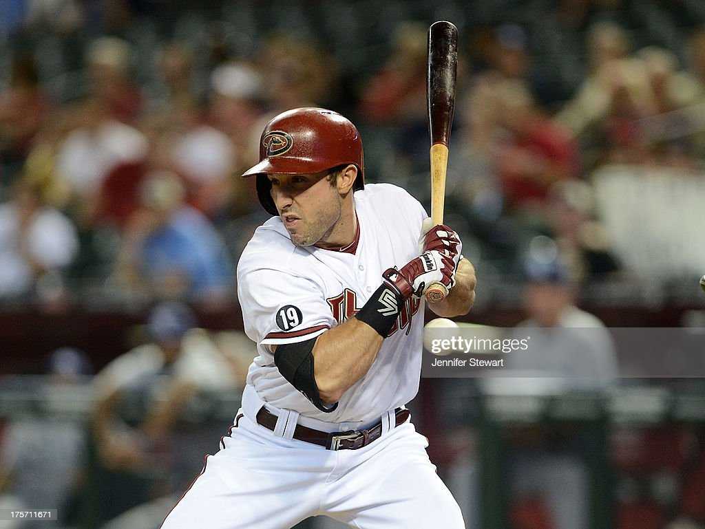 Outfielder <a gi-track='captionPersonalityLinkClicked' href=/galleries/search?phrase=Adam+Eaton&family=editorial&specificpeople=210898 ng-click='$event.stopPropagation()'>Adam Eaton</a> #6 of the Arizona Diamondbacks is hit by a pitch during the third inning of the game against the Tampa Bay Rays at Chase Field on August 6, 2013 in Phoenix, Arizona.