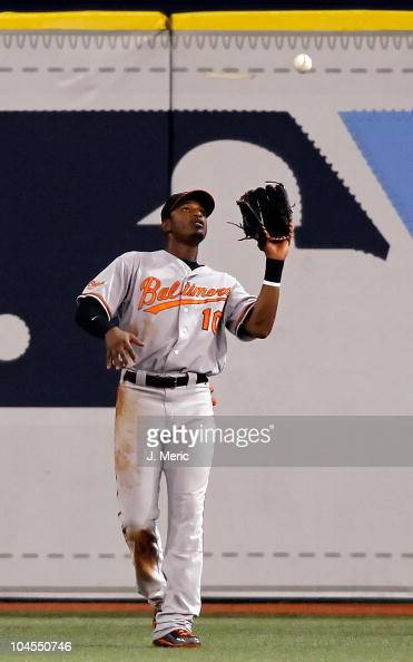 Outfielder Adam Jones of the Baltimore Orioles catches a fly ball against the Tampa Bay Rays during the game at Tropicana Field on September 29 2010...