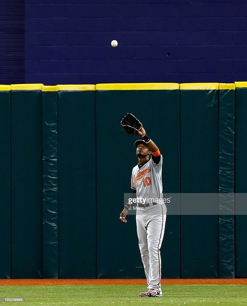 Outfielder Adam Jones #10 of the Baltimore Orioles catches a fly ball against the Tampa Bay Rays during the game at Tropicana Field on October 1, 2012 in St. Petersburg, Florida.