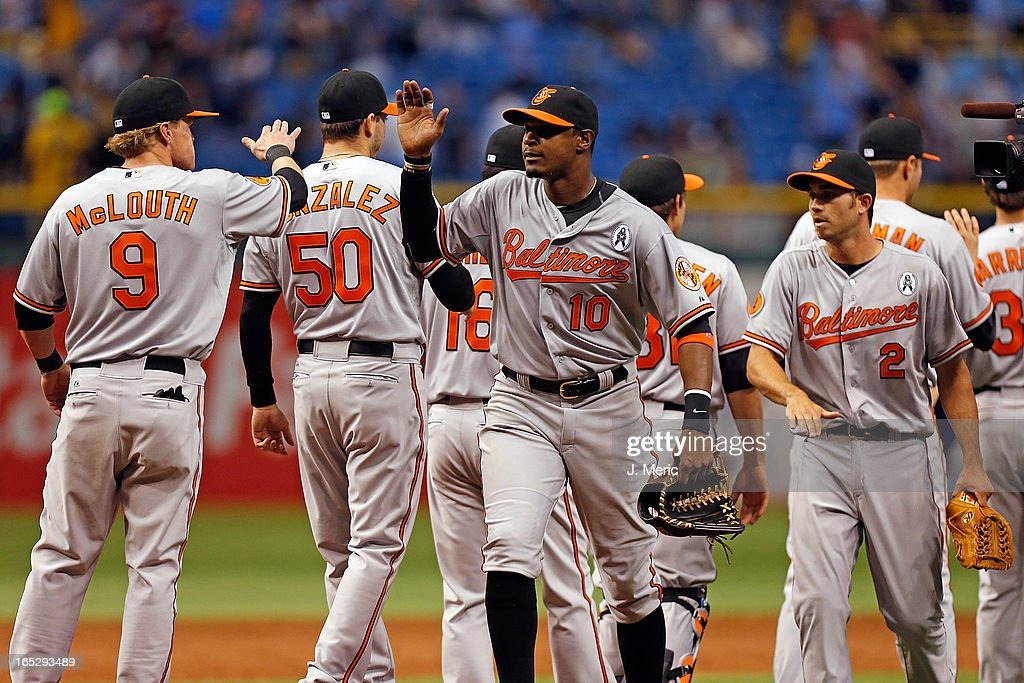 Outfielder Adam Jones #10 of the Baltimore Orioles celebrates his team's 7-4 victory over the Tampa Bay Rays during the Opening Day game at Tropicana Field on April 2, 2013 in St. Petersburg, Florida.