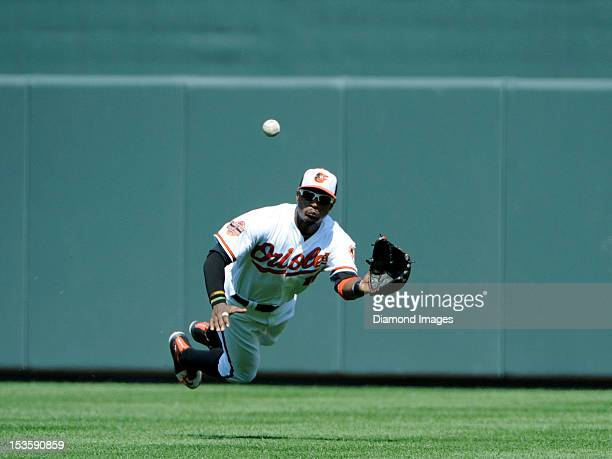 Outfielder Adam Jones of the Baltimore Orioles dives to catch a sacrifice flyball off the bat of Jeff Keppinger of the Tampa Bay Rays during the top...