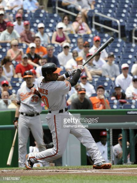 Outfielder Adam Jones of the Baltimore Orioles hits a solo home run during the top of the first inning of an interleague game on June 18 2011 against...