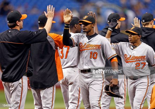Outfielder Adam Jones of the Baltimore Orioles is congratulated after the the Orioles victory over the Tampa Bay Rays at Tropicana Field on October 2...