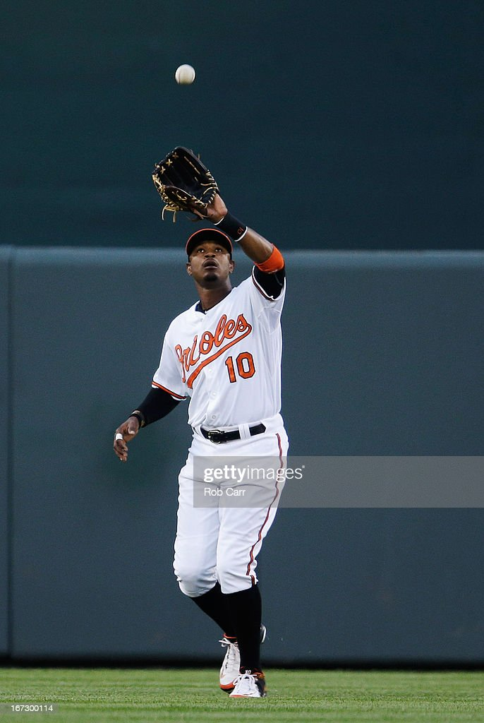Outfielder Adam Jones #10 of the Baltimore Orioles makes a catch against the Toronto Blue Jays at Oriole Park at Camden Yards on April 23, 2013 in Baltimore, Maryland.