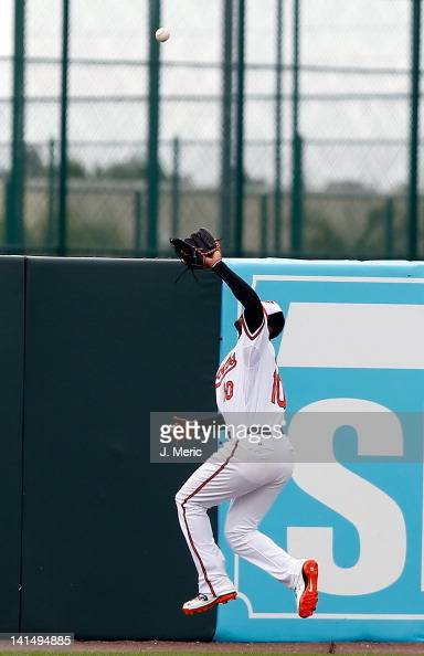 Outfielder Adam Jones of the Baltimore Orioles makes the play against the Boston Red Sox during a Grapefruit League Spring Training Game at Ed Smith...