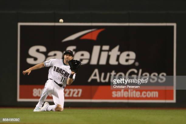 Outfielder AJ Pollock of the Arizona Diamondbacks makes a diving catch during the fourth inning of the National League Wild Card game against the...