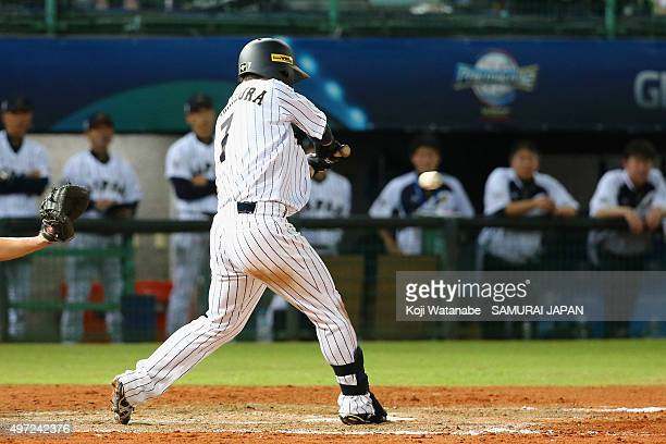 Outfielder Akira Nakamura of Japan hits a walkoff single in the bottom of ninth inning during the WBSC Premier 12 match between Venezuela and Japan...
