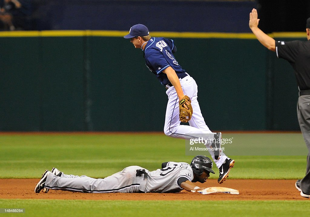 Outfielder <a gi-track='captionPersonalityLinkClicked' href=/galleries/search?phrase=Alejandro+De+Aza&family=editorial&specificpeople=4181650 ng-click='$event.stopPropagation()'>Alejandro De Aza</a> #30 of the Chicago White Sox dives into second base on a pick off attempt against the Tampa Bay Rays May 30, 2012 at Tropicana Field in St. Petersburg, Florida.