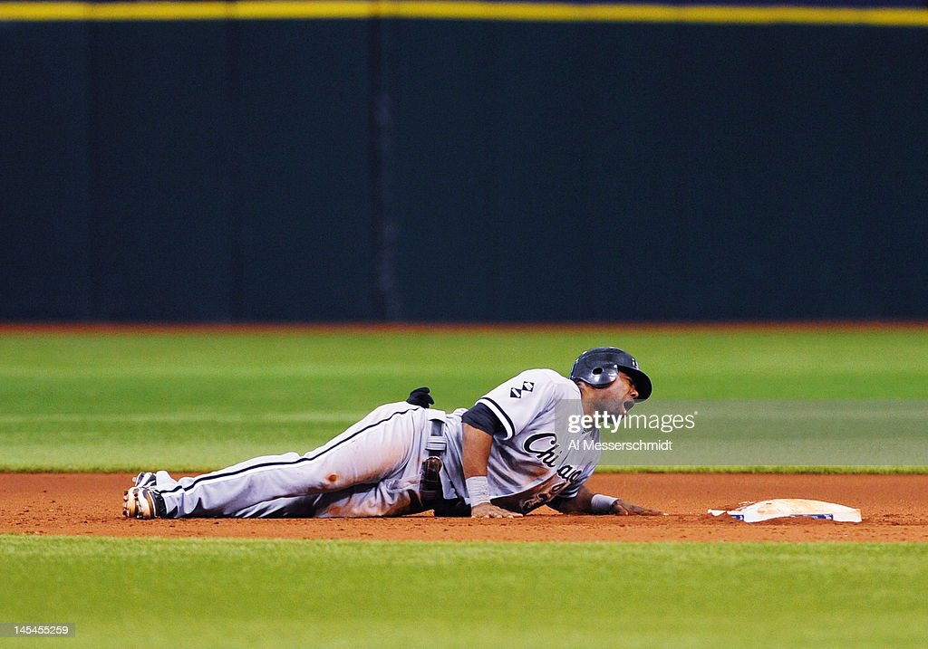 Outfielder <a gi-track='captionPersonalityLinkClicked' href=/galleries/search?phrase=Alejandro+De+Aza&family=editorial&specificpeople=4181650 ng-click='$event.stopPropagation()'>Alejandro De Aza</a> #30 of the Chicago White Sox tumbles in pain at second base after he is hit by a ball during a pick off attempt against the Tampa Bay Rays May 30, 2012 at Tropicana Field in St. Petersburg, Florida.