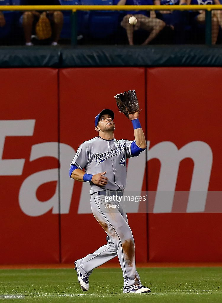 Outfielder <a gi-track='captionPersonalityLinkClicked' href=/galleries/search?phrase=Alex+Gordon+-+Baseball+Player&family=editorial&specificpeople=4494252 ng-click='$event.stopPropagation()'>Alex Gordon</a> #4 of the Kansas City Royals catches a fly ball against the Tampa Bay Rays during the game at Tropicana Field on August 20, 2012 in St. Petersburg, Florida.