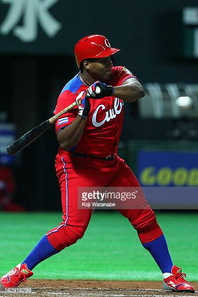 Outfielder Alfredo Despaigne of Cuba hits a single in the top half of the third inning during the friendly game between Fukuoka Softbank Hawks and...