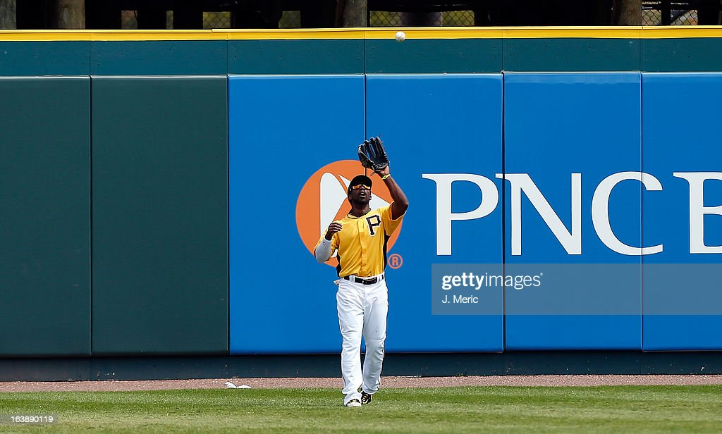 Outfielder <a gi-track='captionPersonalityLinkClicked' href=/galleries/search?phrase=Andrew+McCutchen&family=editorial&specificpeople=2364814 ng-click='$event.stopPropagation()'>Andrew McCutchen</a> #22 of the Pittsburgh Pirates catches a fly ball against the New York Yankees during a Grapefruit League Spring Training Game at McKechnie Field on March 17, 2013 in Bradenton, Florida.