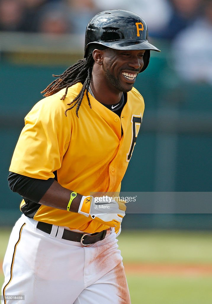 Outfielder <a gi-track='captionPersonalityLinkClicked' href=/galleries/search?phrase=Andrew+McCutchen&family=editorial&specificpeople=2364814 ng-click='$event.stopPropagation()'>Andrew McCutchen</a> #22 of the Pittsburgh Pirates smiles as he jogs to first against the Houston Astros during a Grapefruit League Spring Training Game at McKechnie Field on March 3, 2013 in Bradenton, Florida.