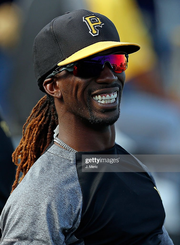 Outfielder Andrew McCutchen #22 of the Pittsburgh Pirates smiles during batting practice just before the start of the Grapefruit League Spring Training Game against the Tampa Bay Rays at the Charlotte Sports Complex on March 25, 2013 in Port Charlotte, Florida.