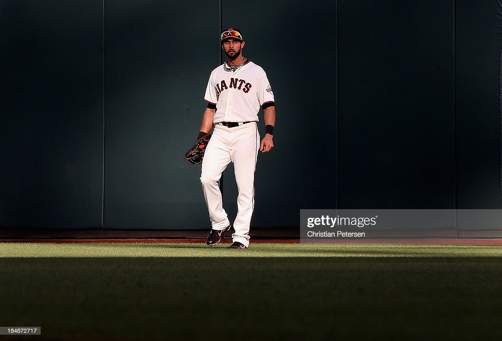 Outfielder <a gi-track='captionPersonalityLinkClicked' href=/galleries/search?phrase=Angel+Pagan&family=editorial&specificpeople=666596 ng-click='$event.stopPropagation()'>Angel Pagan</a> #16 of the San Francisco Giants warms up in the outfield in Game Six of the National League Championship Series against St Louis Cardinals at AT&T Park on October 21, 2012 in San Francisco, California. The Giants defeated the Cardinals 6-1.