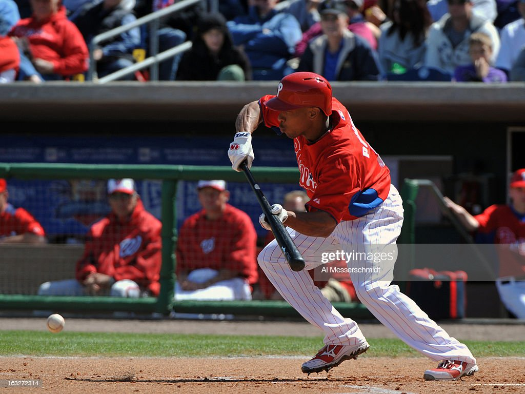 Outfielder <a gi-track='captionPersonalityLinkClicked' href=/galleries/search?phrase=Ben+Revere&family=editorial&specificpeople=6826641 ng-click='$event.stopPropagation()'>Ben Revere</a> #2 of the Philadelphia Phillies bunts against the Washington Nationals March 6, 2013 at Bright House Field in Clearwater, Florida.