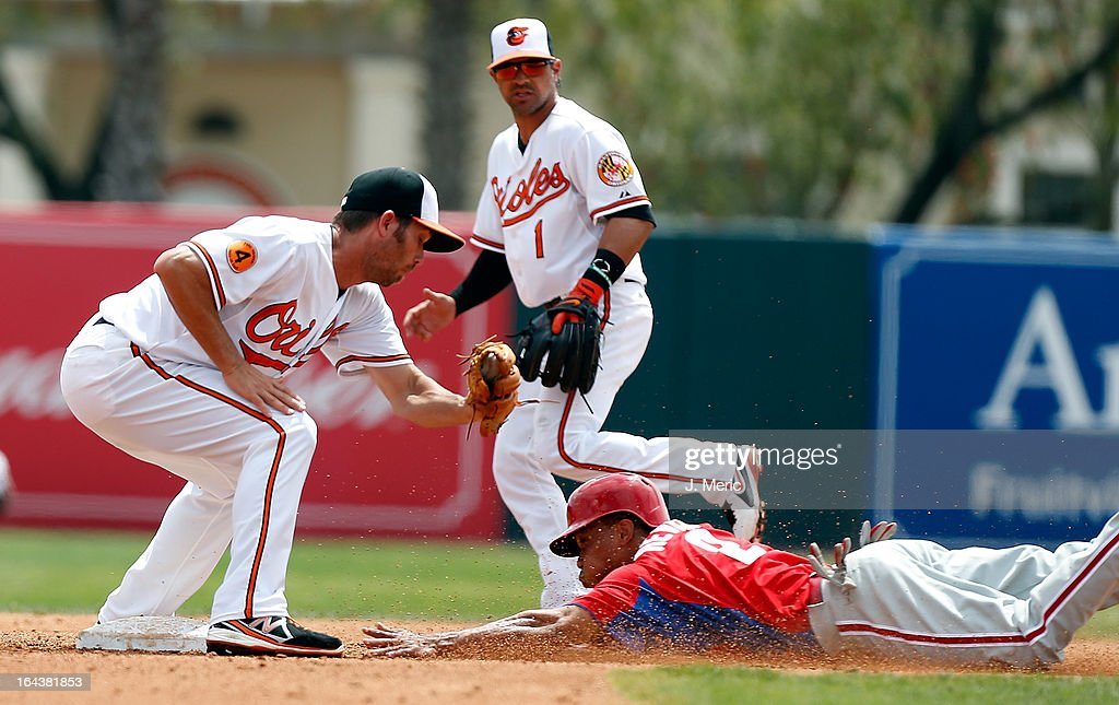Outfielder Ben Revere #2 of the Philadelphia Phillies steals second base as shortstop J.J. Hardy #2 of the Baltimore Orioles takes the throw during a Grapefruit League Spring Training Game at Ed Smith Stadium on March 23, 2013 in Sarasota, Florida.