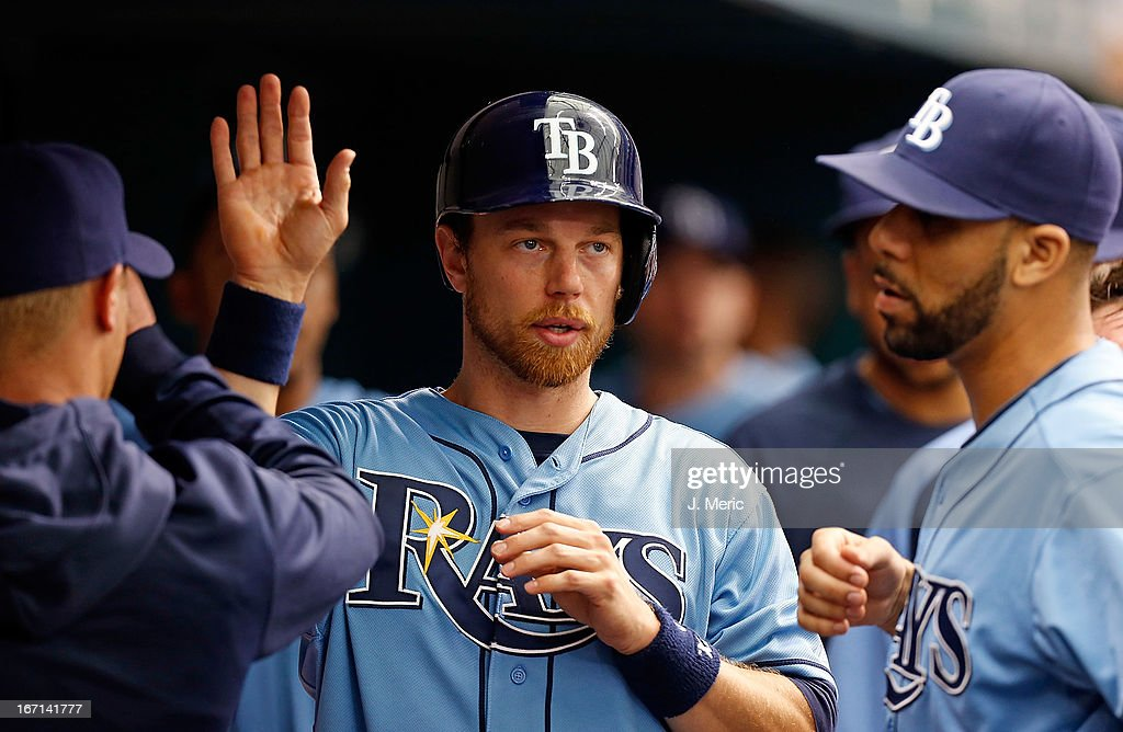 Outfielder <a gi-track='captionPersonalityLinkClicked' href=/galleries/search?phrase=Ben+Zobrist&family=editorial&specificpeople=2120037 ng-click='$event.stopPropagation()'>Ben Zobrist</a> #18 of the Tampa Bay Rays is congratulated after scoring a first inning run against the Oakland Athletics during the game at Tropicana Field on April 21, 2013 in St. Petersburg, Florida.