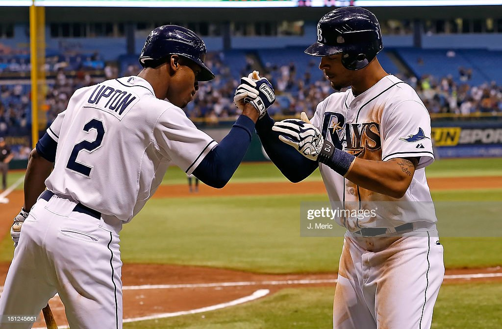 Outfielder B.J. Upton #2 of the Tampa Bay Rays congratulates Desmond Jennings #8 after his home run against the New York Yankees during the game at Tropicana Field on September 4, 2012 in St. Petersburg, Florida.