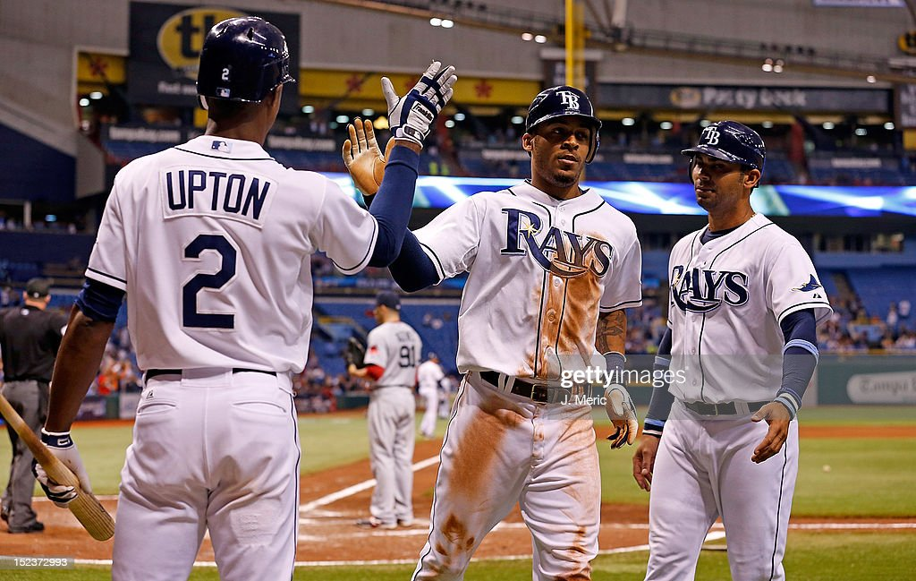 Outfielder <a gi-track='captionPersonalityLinkClicked' href=/galleries/search?phrase=B.J.+Upton&family=editorial&specificpeople=810704 ng-click='$event.stopPropagation()'>B.J. Upton</a> #2 of the Tampa Bay Rays congratulates <a gi-track='captionPersonalityLinkClicked' href=/galleries/search?phrase=Desmond+Jennings&family=editorial&specificpeople=5974085 ng-click='$event.stopPropagation()'>Desmond Jennings</a> #8 after his triple against the Boston Red Sox during the game at Tropicana Field on September 19, 2012 in St. Petersburg, Florida.