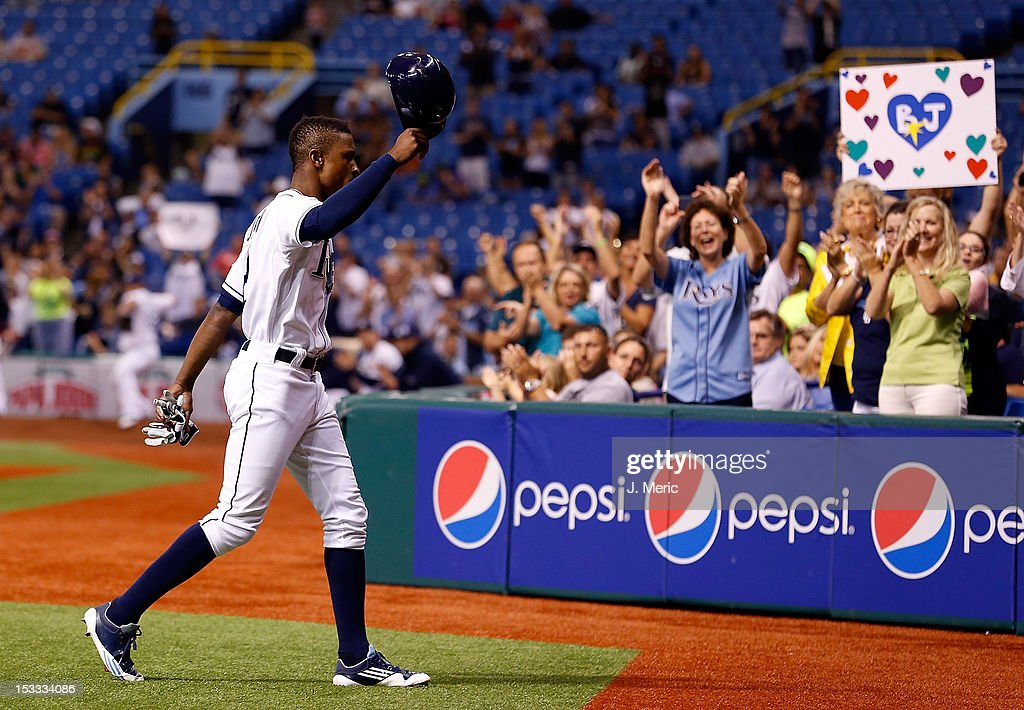 Outfielder <a gi-track='captionPersonalityLinkClicked' href=/galleries/search?phrase=B.J.+Upton&family=editorial&specificpeople=810704 ng-click='$event.stopPropagation()'>B.J. Upton</a> #2 of the Tampa Bay Rays tips his hat to the crowd during the game against the Baltimore Orioles at Tropicana Field on October 3, 2012 in St. Petersburg, Florida.