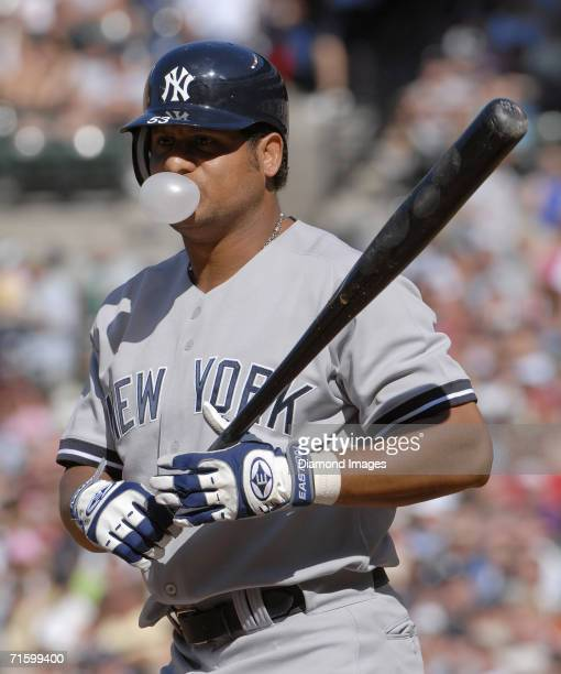 Outfielder Bobby Abreu of the New York Yankees blows a bubble during an at bat in the first inning of a game on August 5 2006 against the Baltimore...