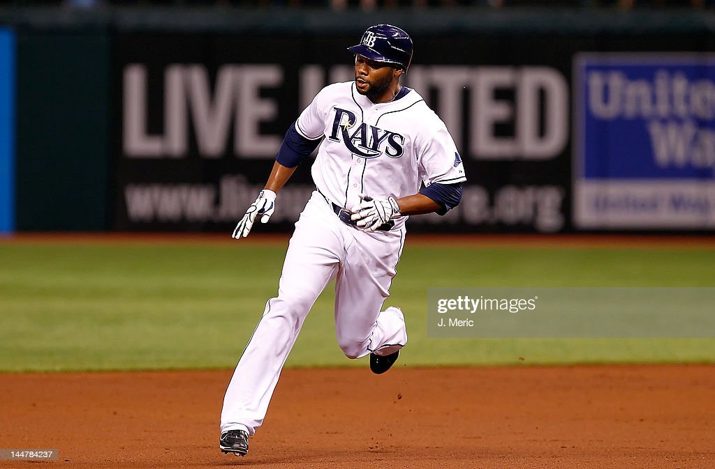 Outfielder <a gi-track='captionPersonalityLinkClicked' href=/galleries/search?phrase=Brandon+Allen+-+Baseball+Player&family=editorial&specificpeople=2238262 ng-click='$event.stopPropagation()'>Brandon Allen</a> #19 of the Tampa Bay Rays advances to third against the Seattle Mariners during the game at Tropicana Field on April 30, 2012 in St. Petersburg, Florida.