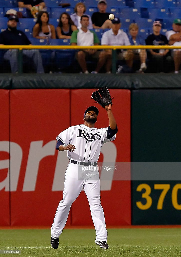 Outfielder <a gi-track='captionPersonalityLinkClicked' href=/galleries/search?phrase=Brandon+Allen+-+Baseball+Player&family=editorial&specificpeople=2238262 ng-click='$event.stopPropagation()'>Brandon Allen</a> #19 of the Tampa Bay Rays catches a fly ball against the Seattle Mariners during the game at Tropicana Field on April 30, 2012 in St. Petersburg, Florida.