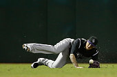 Outfielder Brandon Barnes of the Colorado Rockies is unable to catch a single hit by Jake Lamb of the Arizona Diamondbacks during the sixth inning of...