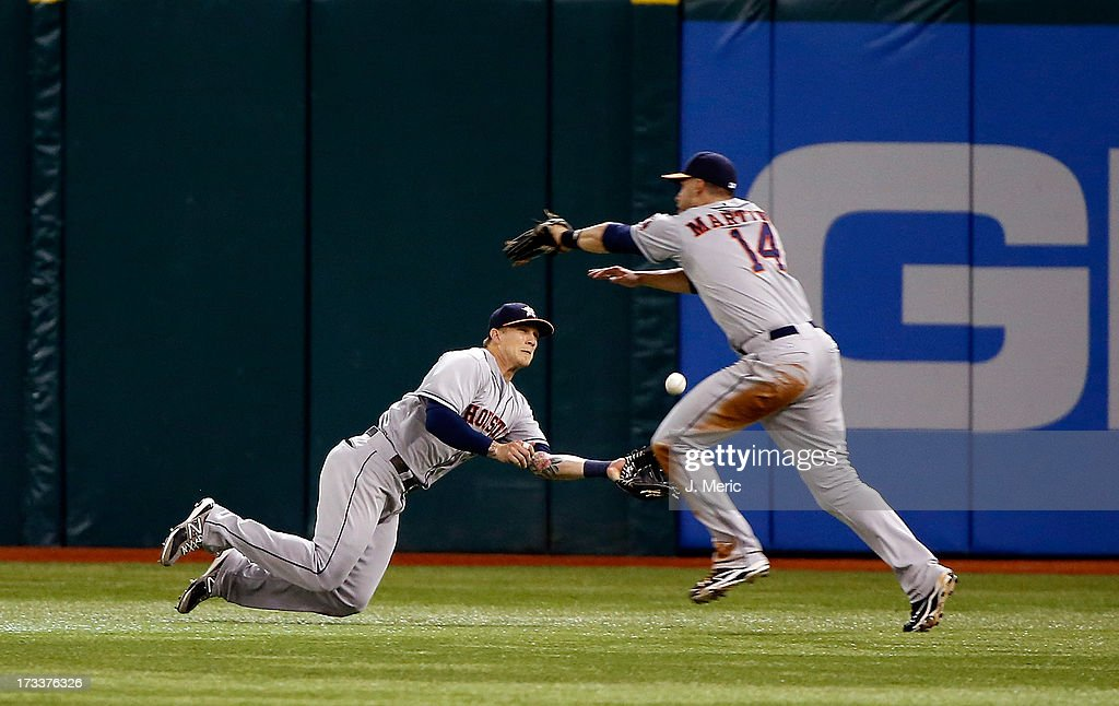 Outfielder Brandon Barnes #2 of the Houston Astros makes a sliding catch on a fly ball against the Tampa Bay Rays during the game at Tropicana Field on July 12, 2013 in St. Petersburg, Florida.