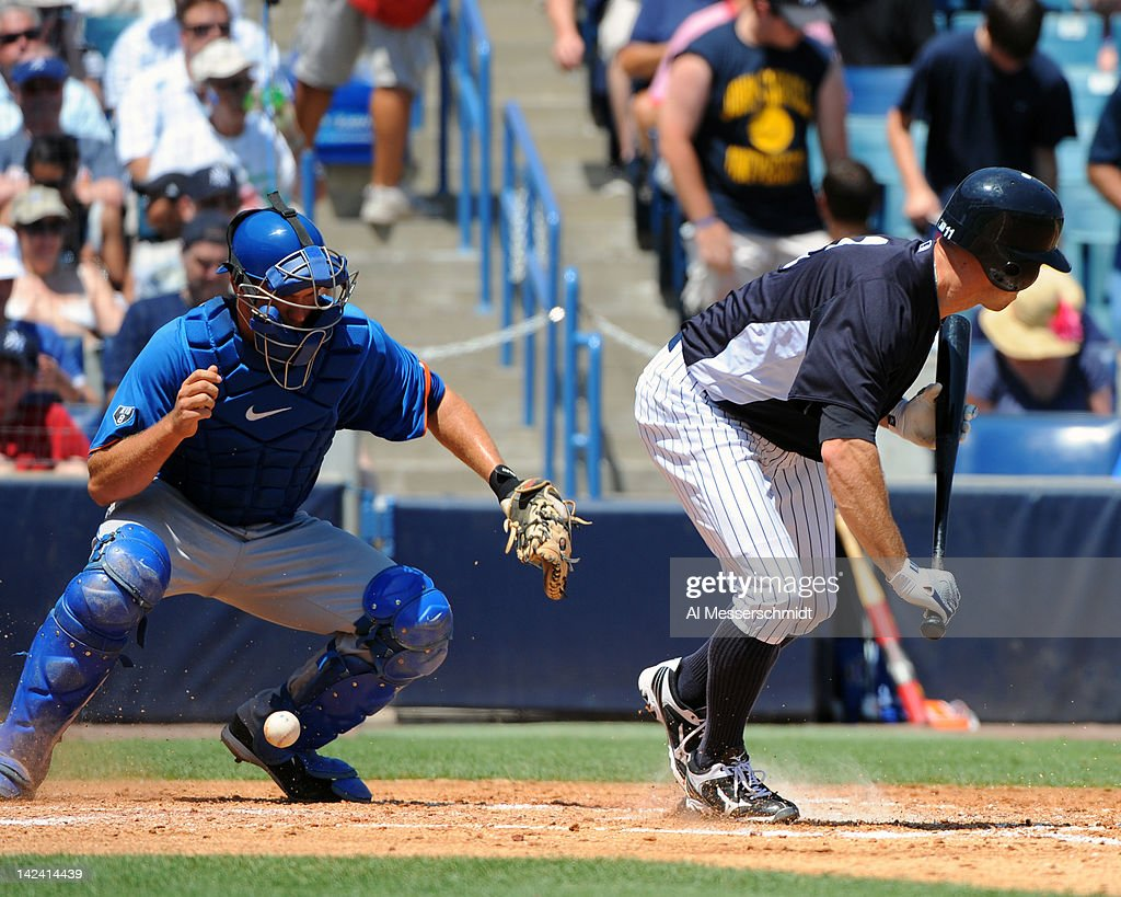 Outfielder <a gi-track='captionPersonalityLinkClicked' href=/galleries/search?phrase=Brett+Gardner&family=editorial&specificpeople=4172518 ng-click='$event.stopPropagation()'>Brett Gardner</a> #11 of the New York Yankees attempts a bunt as catcher <a gi-track='captionPersonalityLinkClicked' href=/galleries/search?phrase=Josh+Thole&family=editorial&specificpeople=5741573 ng-click='$event.stopPropagation()'>Josh Thole</a> #30 of the New York Mets fields a ball in a spring training game April 4, 2012 at George M. Steinbrenner Field in Tampa, Florida.