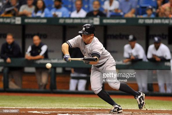 Outfielder Brett Gardner of the New York Yankees attempts a bunt in the first inning against the Tampa Bay Rays May 24 2013 at Tropicana Field in St...
