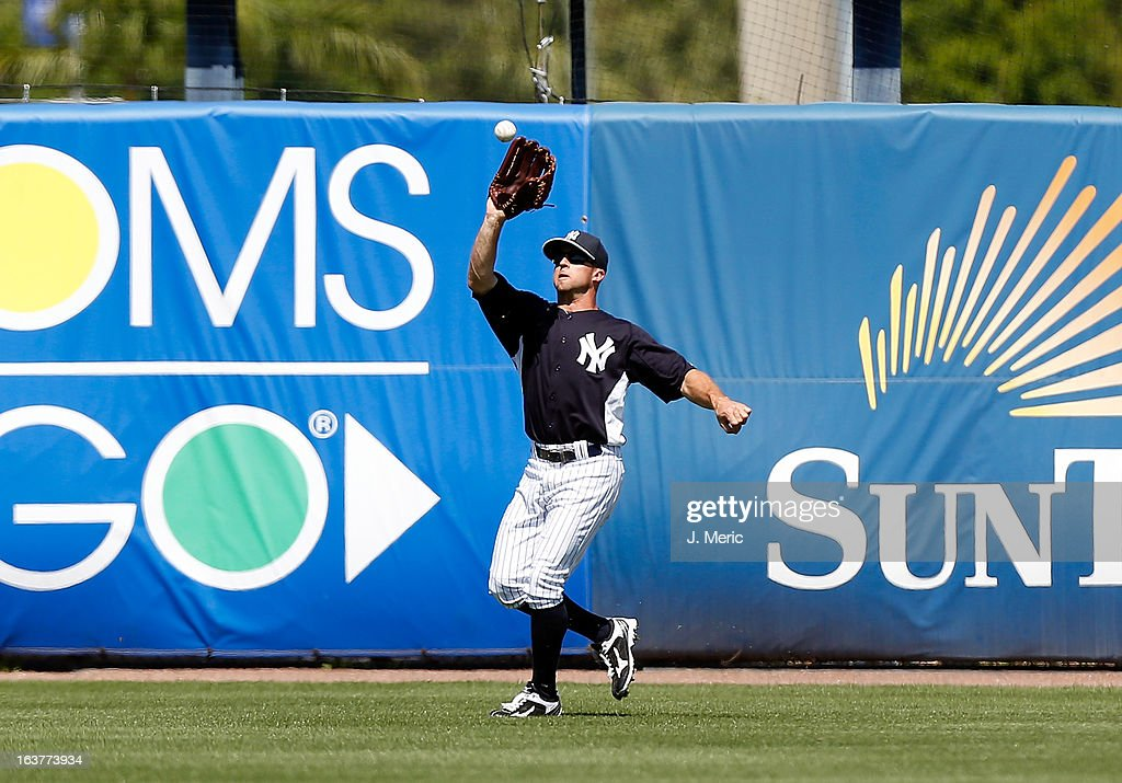Outfielder <a gi-track='captionPersonalityLinkClicked' href=/galleries/search?phrase=Brett+Gardner&family=editorial&specificpeople=4172518 ng-click='$event.stopPropagation()'>Brett Gardner</a> #11 of the New York Yankees catches a fly ball against the Miami Marlins during a Grapefruit League Spring Training Game at George M. Steinbrenner Field on March 15, 2013 in Tampa, Florida.