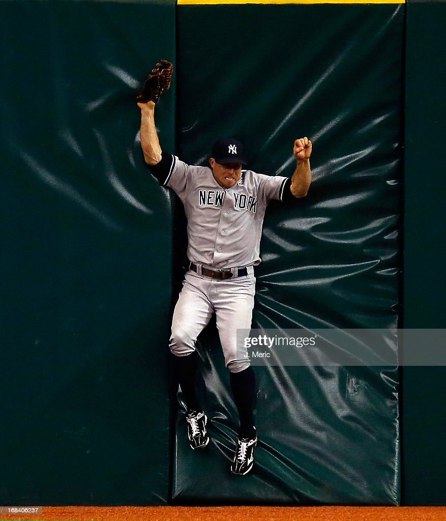 Outfielder <a gi-track='captionPersonalityLinkClicked' href=/galleries/search?phrase=Brett+Gardner&family=editorial&specificpeople=4172518 ng-click='$event.stopPropagation()'>Brett Gardner</a> #11 of the New York Yankees catches a fly ball against the centerfield wall during the game against the Tampa Bay Rays at Tropicana Field on April 23, 2013 in St. Petersburg, Florida.