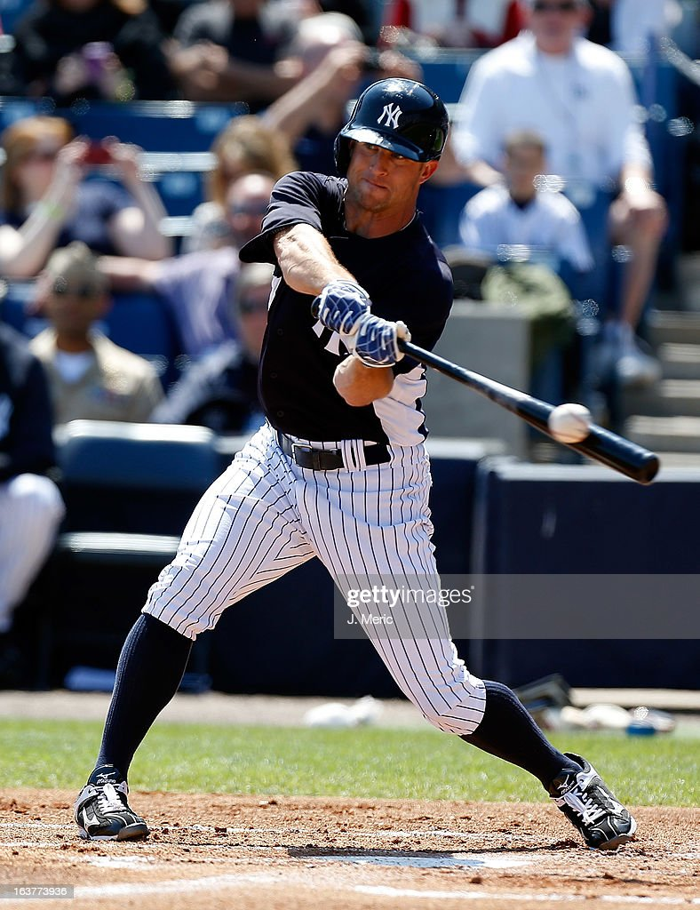 Outfielder Brett Gardner #11 of the New York Yankees fouls off a pitch against the Miami Marlins during a Grapefruit League Spring Training Game at George M. Steinbrenner Field on March 15, 2013 in Tampa, Florida.