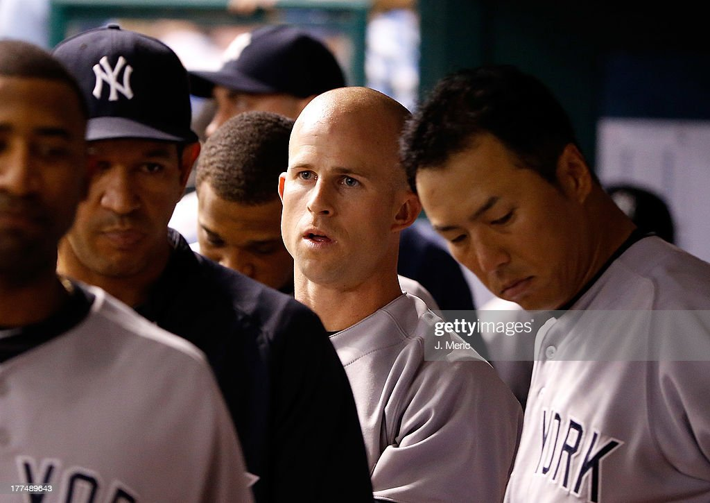 Outfielder <a gi-track='captionPersonalityLinkClicked' href=/galleries/search?phrase=Brett+Gardner&family=editorial&specificpeople=4172518 ng-click='$event.stopPropagation()'>Brett Gardner</a> #11 of the New York Yankees is congratulated after scoring a first inning run against the Tampa Bay Rays during the game at Tropicana Field on August 23, 2013 in St. Petersburg, Florida.