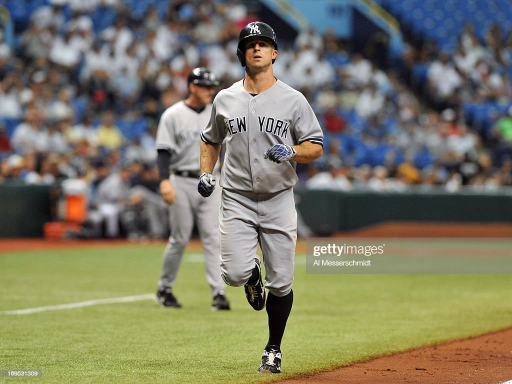 Outfielder <a gi-track='captionPersonalityLinkClicked' href=/galleries/search?phrase=Brett+Gardner&family=editorial&specificpeople=4172518 ng-click='$event.stopPropagation()'>Brett Gardner</a> #11 of the New York Yankees runs to home plate after a home run in the 9th inning against the Tampa Bay Rays May 26, 2013 at Tropicana Field in St. Petersburg, Florida. The Rays won 8 - 3.