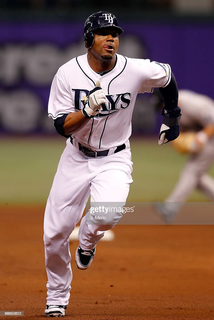 Outfielder <a gi-track='captionPersonalityLinkClicked' href=/galleries/search?phrase=Carl+Crawford&family=editorial&specificpeople=208074 ng-click='$event.stopPropagation()'>Carl Crawford</a> #13 of the Tampa Bay Rays advances against the Toronto Blue Jays during the game at Tropicana Field on April 24, 2010 in St. Petersburg, Florida.