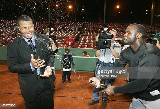 Outfielder Carl Everett of the Chicago White Sox celebrates by spraying champagne on General Manager Ken Williams after winning Game Three of the...