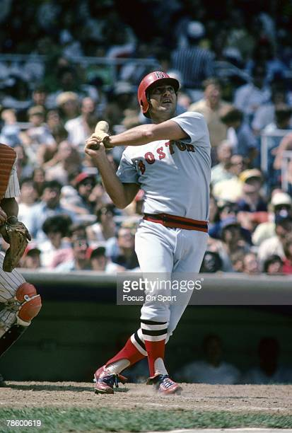 Outfielder Carl Yastrzemski of the Boston Red Sox swings and watches the flight of his ball against the New York Yankees during a MLB baseball game...