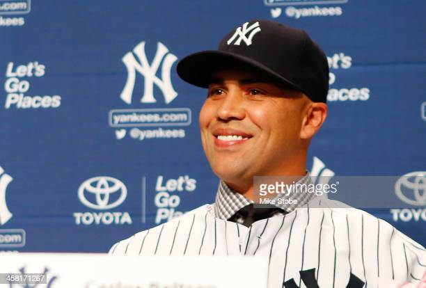Outfielder Carlos Beltran speaks to the media during his introductory press conference at Yankee Stadium on December 20 2013 in the Bronx borough of...