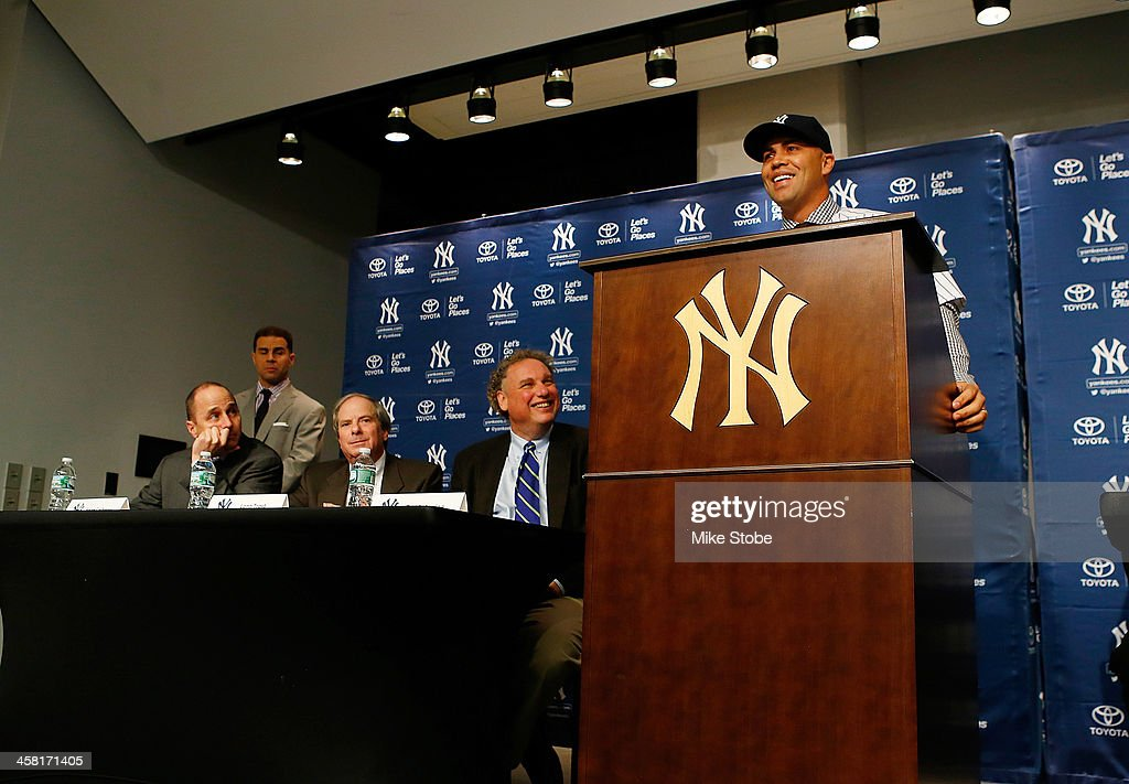 Outfielder <a gi-track='captionPersonalityLinkClicked' href=/galleries/search?phrase=Carlos+Beltran&family=editorial&specificpeople=167108 ng-click='$event.stopPropagation()'>Carlos Beltran</a> speaks to the media during his introductory press conference at Yankee Stadium on December 20, 2013 in the Bronx borough of New York City.