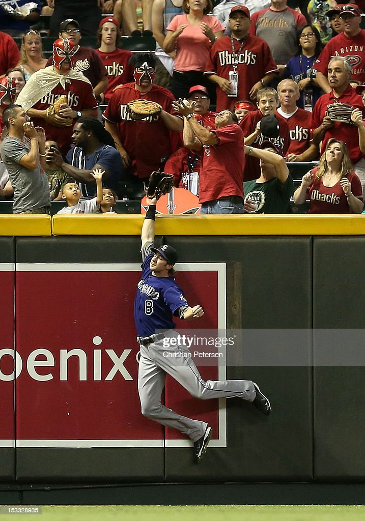 Outfielder Charlie Blackmon #8 of the Colorado Rockies leaps in an attempt to catch a solo home run hit by A.J. Pollock (not pictured) of the Arizona Diamondbacks during the thrid inning of the MLB game at Chase Field on October 3, 2012 in Phoenix, Arizona.