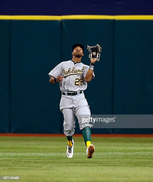 Outfielder Chris Young of the Oakland Athletics catches a fly ball against the Tampa Bay Rays during the game at Tropicana Field on April 21 2013 in...